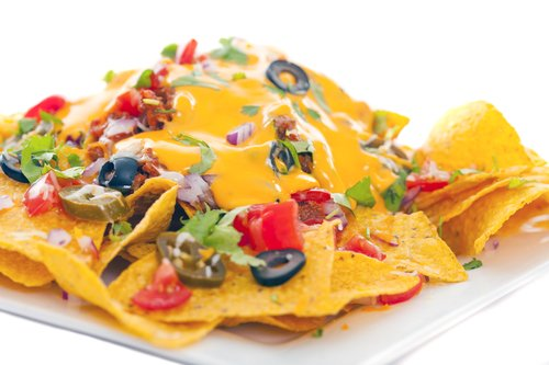Ultimate Nachos - Plate of fresh nachos with a spicy jalapeno cheese sauce