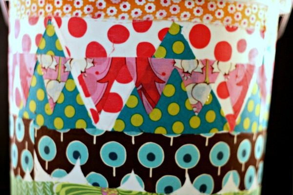 What to Decoupage | This great idea is a 5 gallon bucket turned craft room trash can! Get creative with Mod podge.