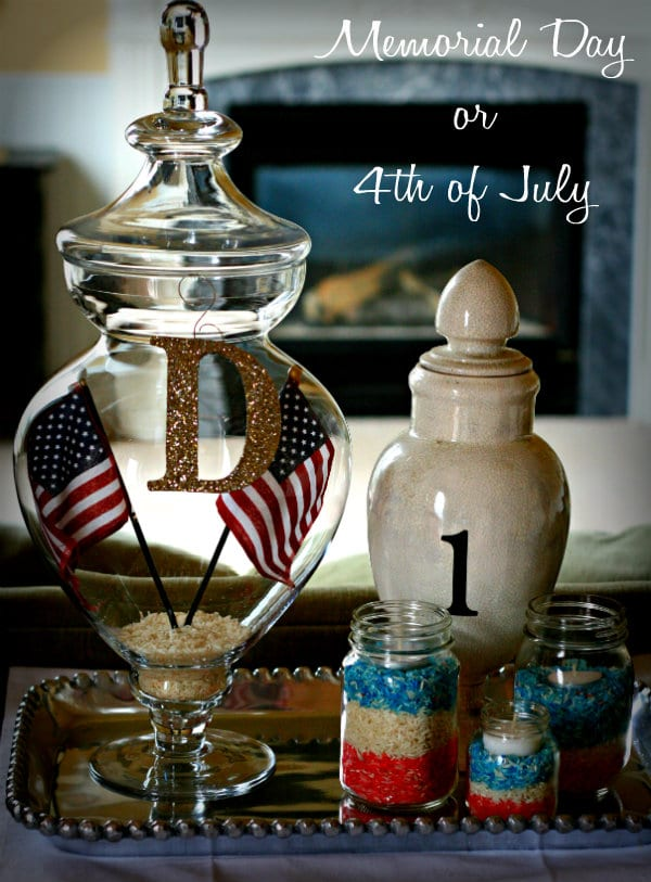 Patriotic Decorating vignette with mason jars filled with layered red, white and blue colored rice.