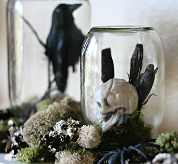 Halloween crows and skeletons inside a glass jar