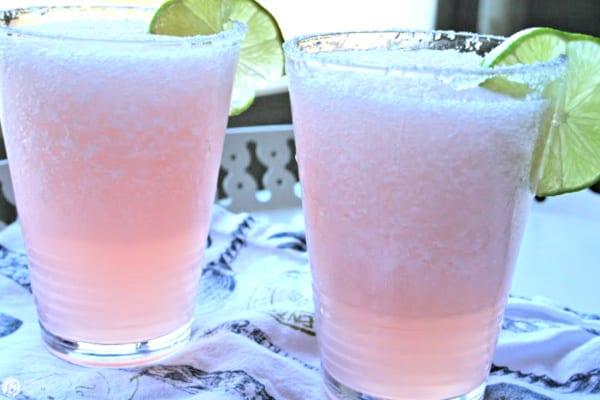 2 glasses with pink grapefruit margaritas