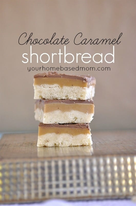 a stack of layered chocolate caramel shortbread cookies