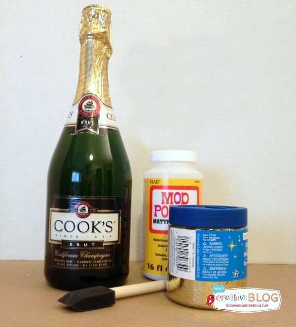 How to Make Glittered Champagne Bottles | Make this easy New Years Eve or Wedding decor with this simple tutorial. See more on TodaysCreativeLife.com