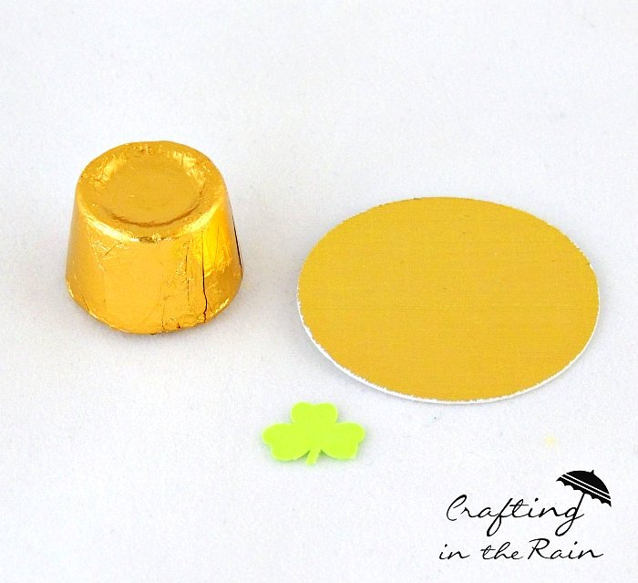 Rolo Candy, with Gold paper circle to make hats.