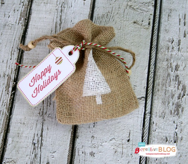 DIY Stamped Burlap Gift Bags | Create beautiful and easy gift wrapped presents by using burlap gift bags! Perfect for small gifts. Using foam stamps and acrylic paint, this was an easy Christmas holiday craft. See full tutorial on TodaysCreativeLife.com
