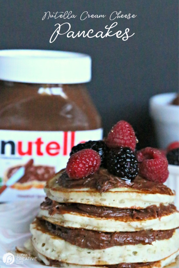 Stack of pancakes with nutella spread