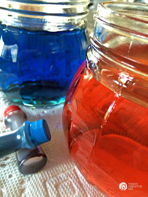 Red and blue water in glass jars