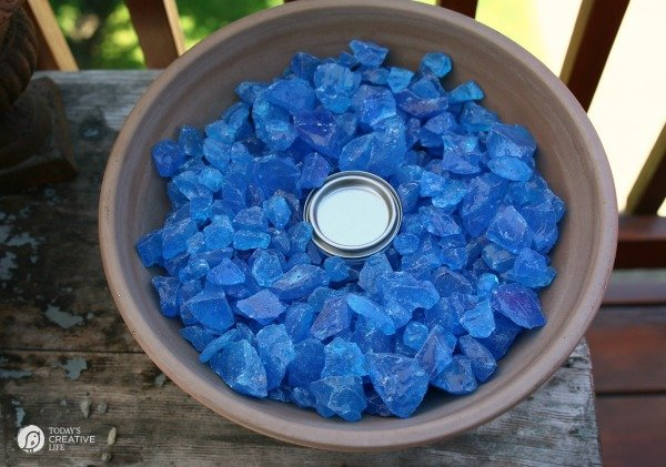 large flower pot filled with blue fire glass