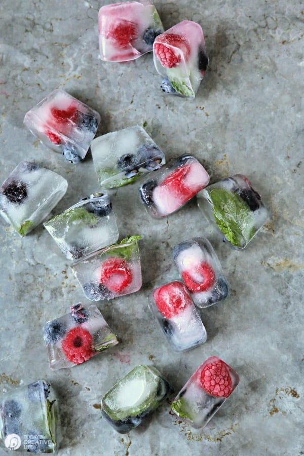 fruit filled ice cubes on a metal tray