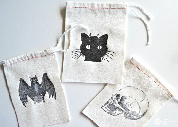 DIY Halloween Goodie Bags by BoxwoodAvenue.com for TodaysCreativeLife.com | Perfect for handing out special treats or use for a great Halloween party goodie bag. Easy iron on transfers make them extra spooky!