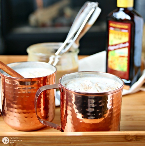 2 copper mugs filled with Hot Buttered Rum