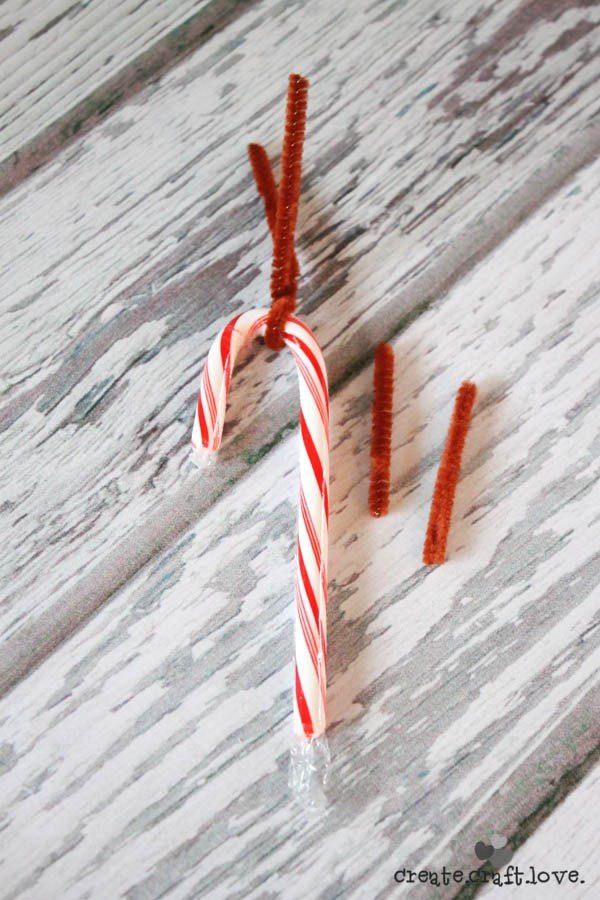 Candy Cane Crafts| These Candy Cane Reindeer are super easy to make and perfect for classroom Christmas parties! via createcraftlove.com for TodaysCreativeLife.com Creative Girls Holiday Soiree.