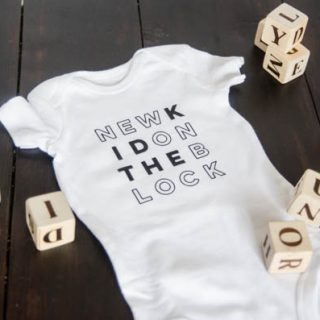DIY Cricut Iron On Onesie   Creative contributor Lemon thistle has created this adorable custom designed baby onesie and is sharing the free graphic. Follow this easy tutorial by clicking on the photo. TodaysCreativeLife.com