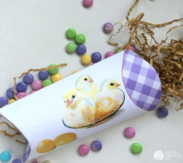 Easter Pillow Box with Easter candy spilling out.