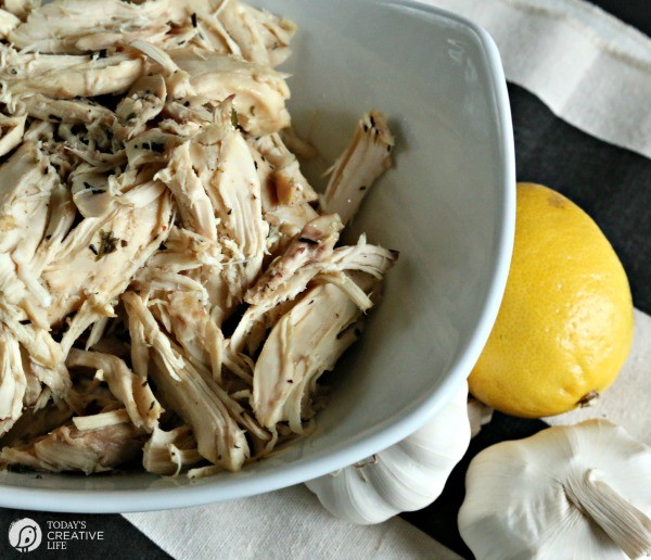 Crockpot Lemon Garlic Chicken | This recipe has 30 garlic cloves and makes the perfect shredded chicken for many meals. Use a whole chicken or just chicken breasts. Click on the photo for the recipe.