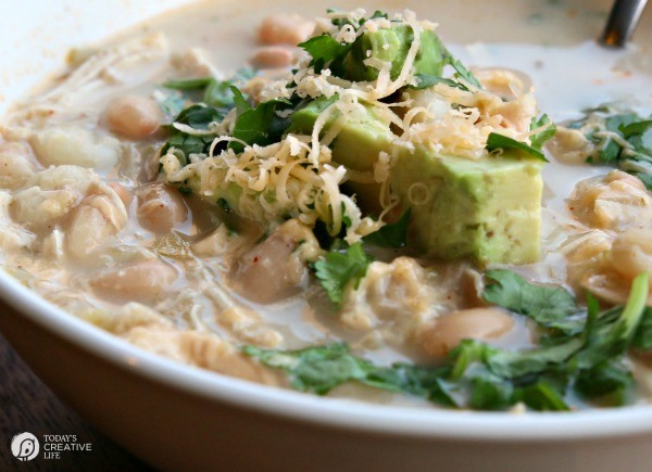White Chicken Chili | Slow cooker or stove top, the choice is yours. This recipe is packed full of flavor with a creamy kick. Healthy and easy! Click the photo for the recipe.