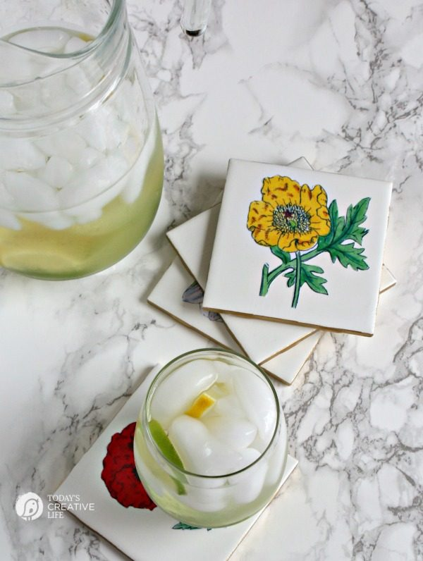 DIY Botanical Coasters | Make your own botanical coasters with ceramic tiles and a little mod podge! Create diy home decor using decoupage. See the tutorial on TodaysCreativeLife.com