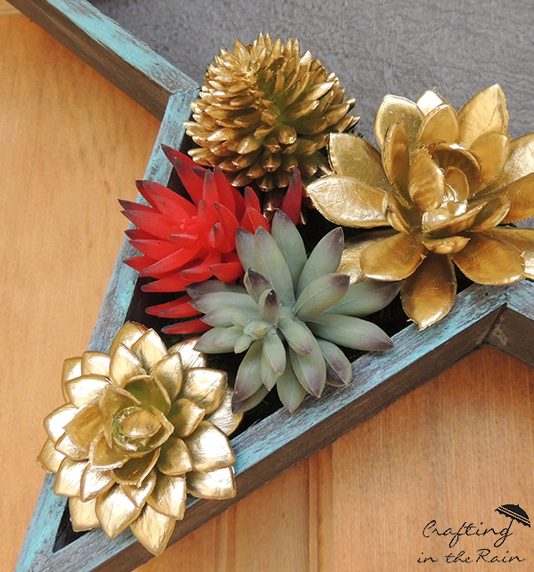 gold painted faux succulents for crafting a DIY Patriotic Door Decor