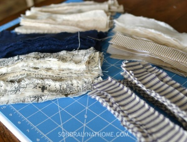 Getting the fabric strips started with scissors so I can tear the rest.