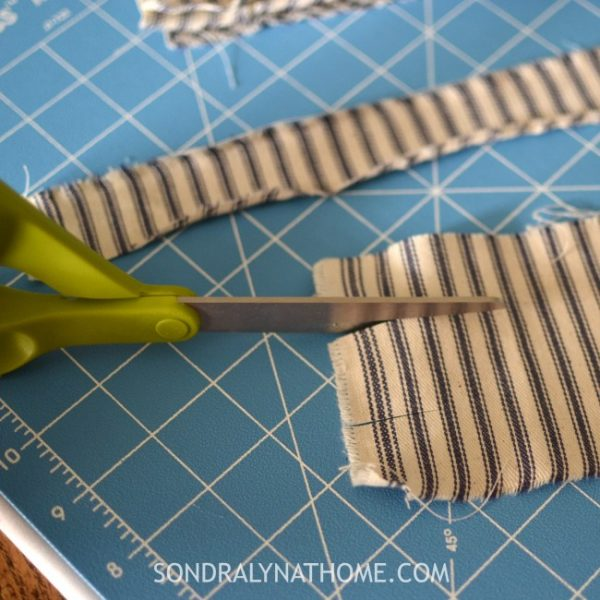 DIY Fabric Scrap Door Wreath | Make this no sew fabric scrap wreath for your next diy home project! Sondra Lyn at Home for TodaysCreativeLife.com