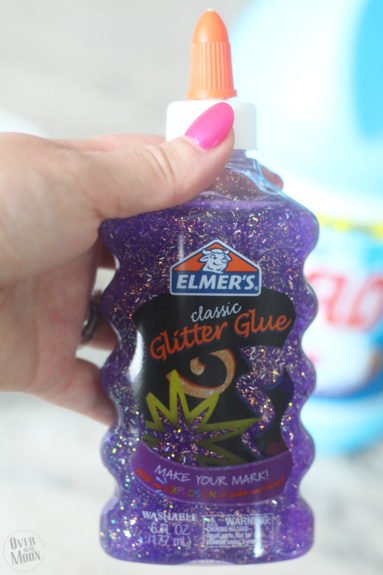 bottle of purple glitter glue for a kids' slime recipe