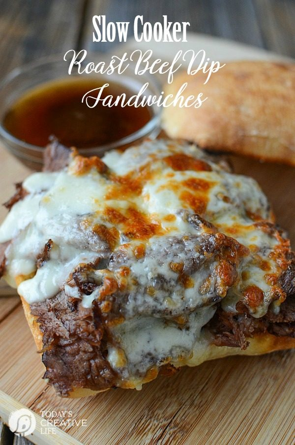 Slow Cooker Roast Beef Dip Sandwiches | This crockpot recipe will become a family favorite. Great for dinners or weekend suppers. French dip sandwiches are everyone's favorite! See the recipe on TodaysCreativeLife.com