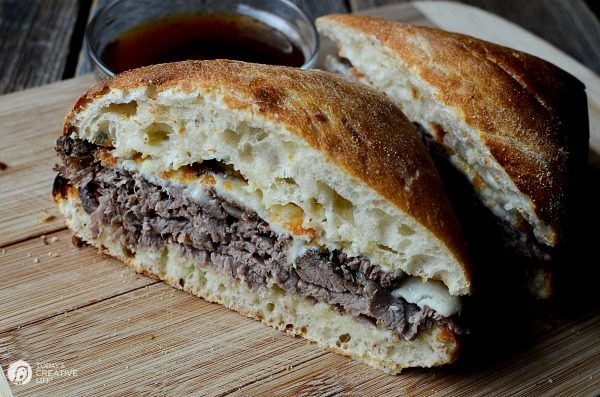 Slow Cooker Roast Beef Dip Sandwiches | This hearty crockpot recipes is for all french dip lovers! Served on a crisp ciabatta roll for extra crunch. Great for family dinners or weekend suppers. Get the recipe on TodaysCreativeLife.com
