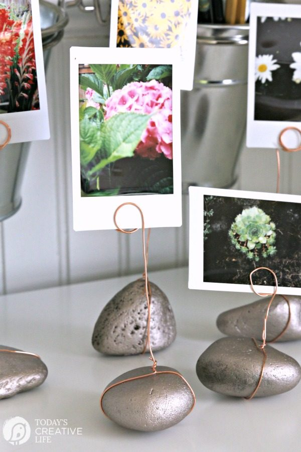 Rock Garden Photo Display |This DIY project is great for displaying any photos. Gather rocks from vacation destinations to display matching vacation photos. Follow my tutorial to make your own. TodaysCreativeLife.com