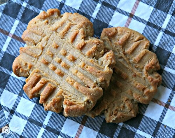 soft and chewy peanut butter cookies on a plaid napkin