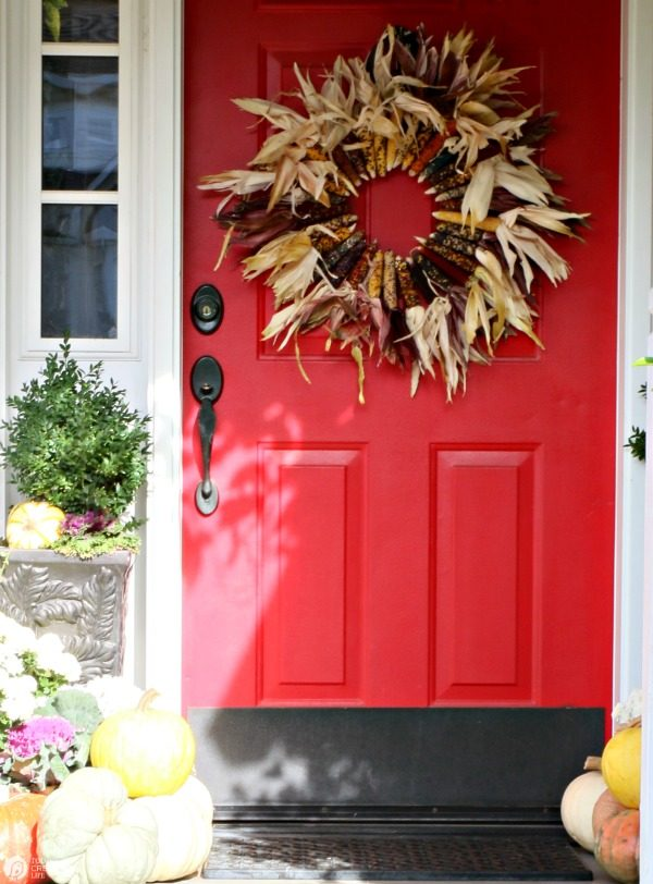 DIY Indian Corn Wreath Fall Porch | Create a fall porch that will welcome your guests in style. DIY Fall Decor is easier than you think. See more by clicking the photo. TodaysCreativeLife.com