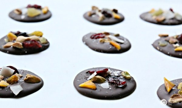 Dark Chocolate Nutty Fruit Bites| Easy holiday gifts from the kitchen. Great for neighbor gifts or to have on hand for last minute gift giving. Free Christmas tag found on TodaysCreativeLife.com