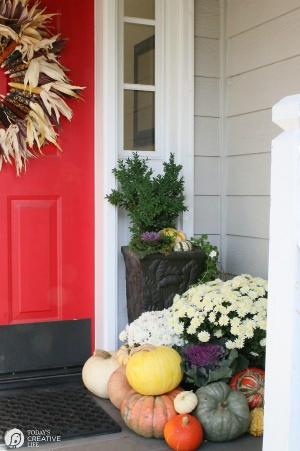 DIY Indian Corn Wreath Fall Porch | Decorate your porch for fall with mums, gourds, pumpkins and this diy fall wreath. Click the photo for more on TodaysCreativeLife.com