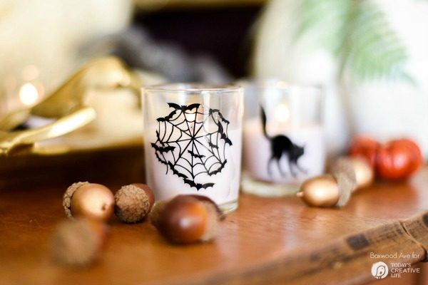 DIY Halloween Votives | Create your own DIY Halloween Decor with this simple craft. Using a Cricut Explore or an Xacto knife for your design. Click the photo for a full tutorial. TodaysCreativeLife.com