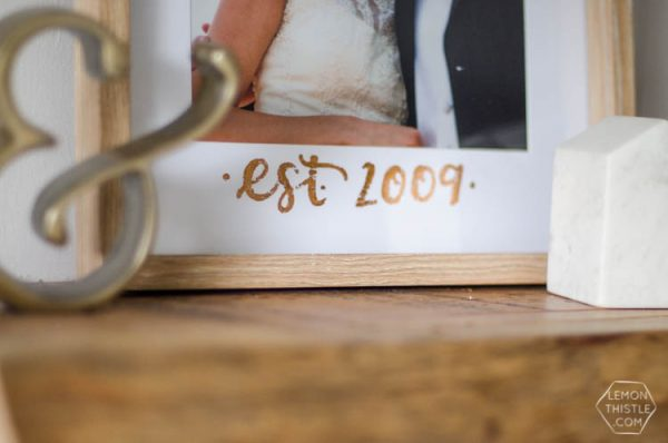 DIY Copper Foiled Photo Mat - What a perfect way to customize a standard photo frame! Hand lettered, foiled, and totally personal- this would make a great wedding gift! Love that it doesn't take a foiling machine