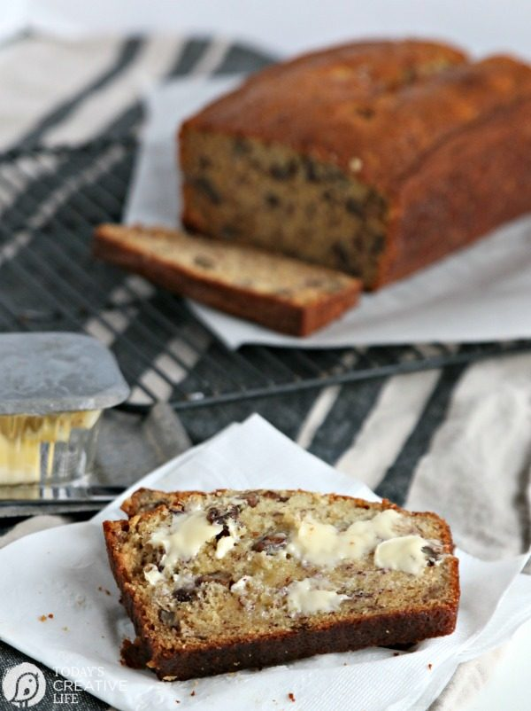 slice of warm banana bread with butter melting on top