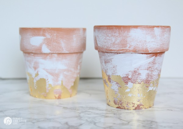 DIY Distressed Gold Leaf Terracotta Pots - How to age a terracotta pot. How to add gold leaf to a terracotta flower pot.