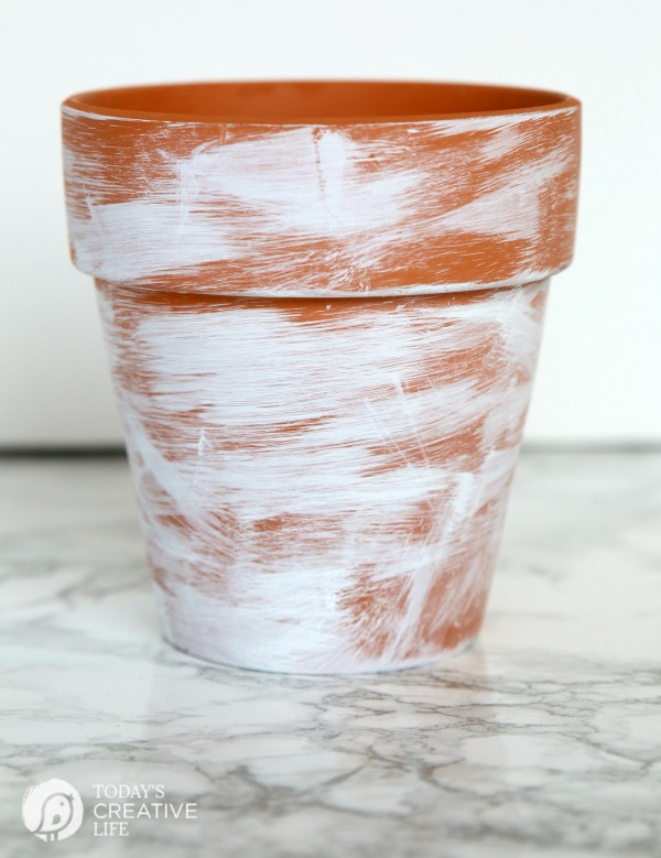 DIY Distressed Gold Leaf Terracotta Pots | How to age a terracotta flower pot with paint.