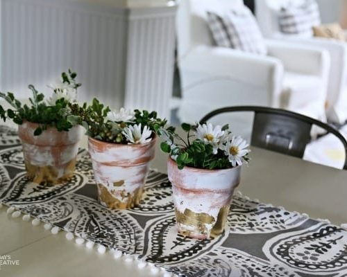 Table Centerpiece Ideas | How to use artificial greens and flowers for perfect everyday decorating for your home. Simple DIY & inexpensive. Easy to create this spring centerpiece in 10 minutes. See more on TodaysCreativeLife.com