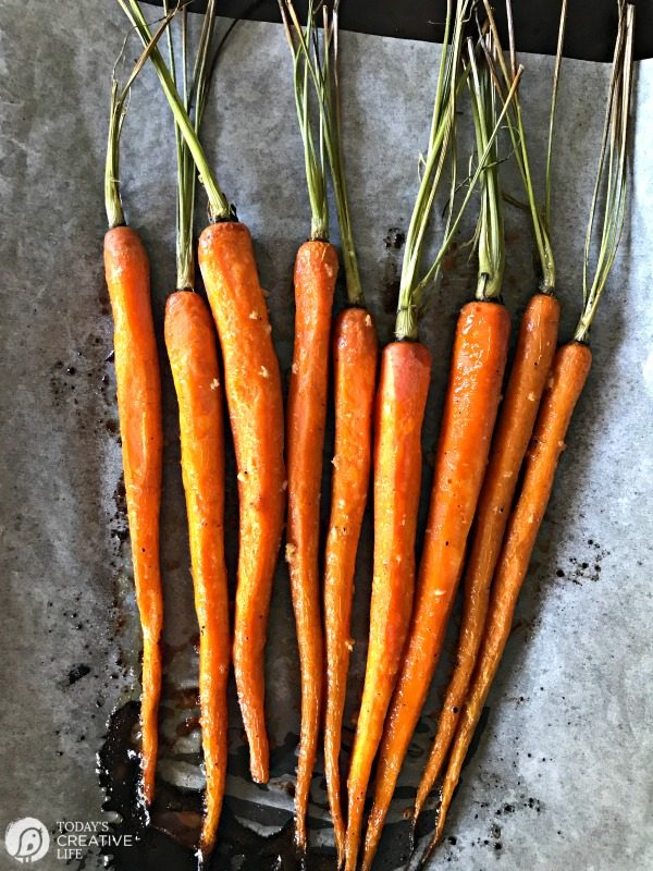 Honey Roasted Carrots with Garlic are savory and sweet. Perfect side dish any time of year. Holiday side dish, Easter Side Dish, vegetable side dish. Click the photo for the recipe. TodaysCreativelife.com