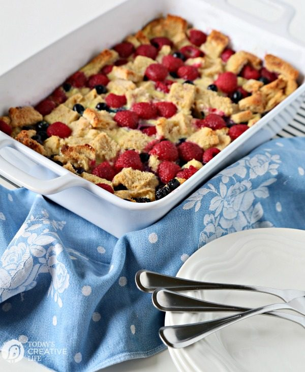French Toast Casserole with berries in a white casserole dish.