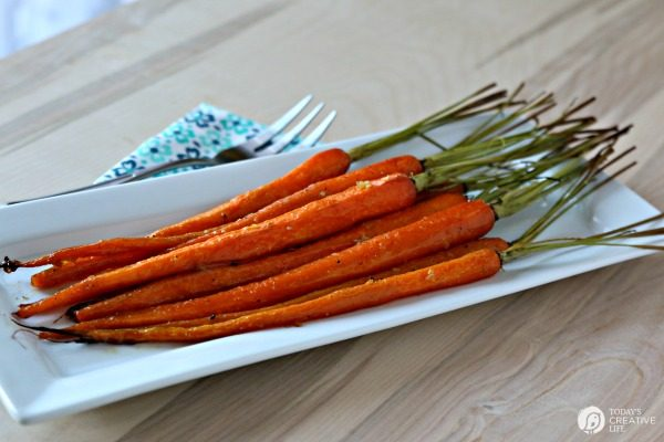 Honey Roasted Carrots with Garlic are savory and sweet. Perfect side dish anytime of year. Holiday side dish, Easter Side Dish, vegetable side dish. Click the photo for the recipe. TodaysCreativelife.com
