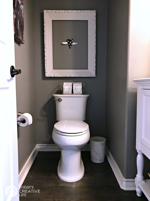 toilet area in a small bathroom