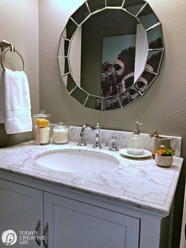 small bathroom vanity and mirror