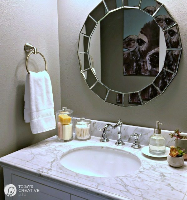 simple bathroom accessories on a small bathroom vanity