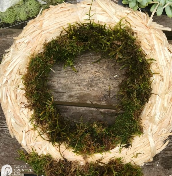 straw wreath with deer moss
