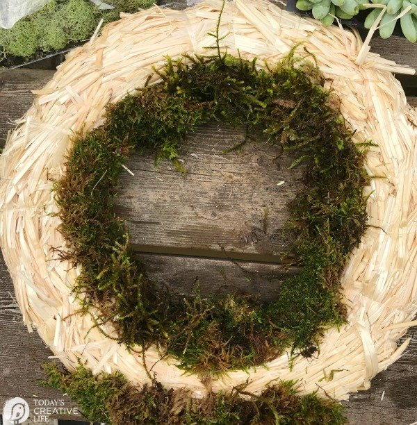 Moss pinned to the inside of the wreath