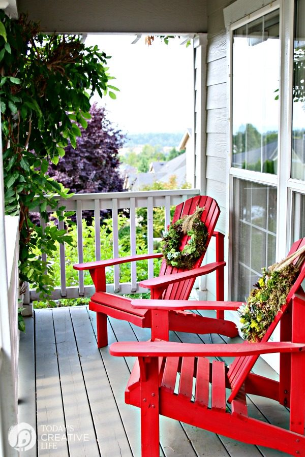 two red wooden deck chairs