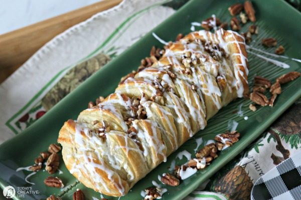 Pumpkin Cream Cheese Puff Pastry Braid topped with glaze and chopped pecans