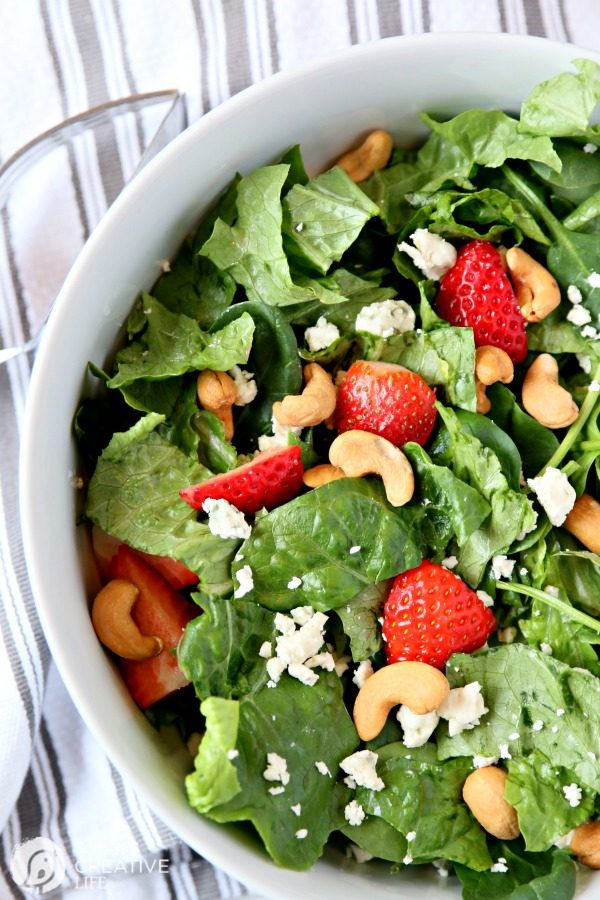 Strawberry Gorgonzola Salad with Cashews | Topped with homemade vinaigrette, loaded with spinach, romaine and Flavor!