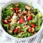 Strawberry Gorgonzola Salad with Cashews | Toped with homemade vinaigrette, loaded with spinach, romaine and Flavor!